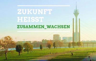 Düsseldorf Panorama mit Schriftzug Zukunft heißt zusammen wachsen
